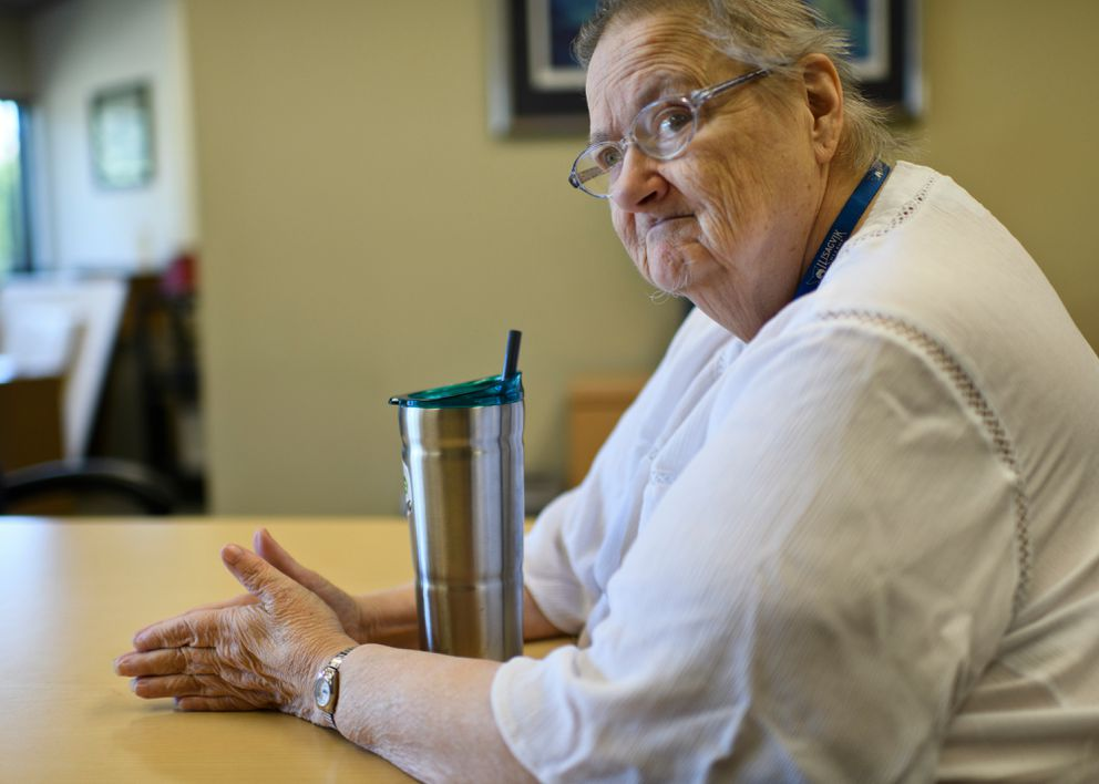 Kathleen Watkins, 74, who volunteers a the Anchorage Senior Activity Center, said the loss of $175 a month for the Alaska Senior Benefits Payment Program makes it difficult to cover her expenses. (Marc Lester / ADN)