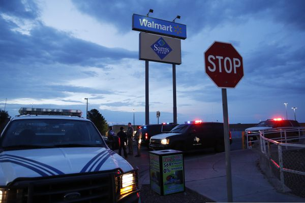 Law enforcement officials block a road at the scene of a mass shooting at a shopping complex Sunday, Aug. 4, 2019, in El Paso, Texas. (AP Photo/John Locher)