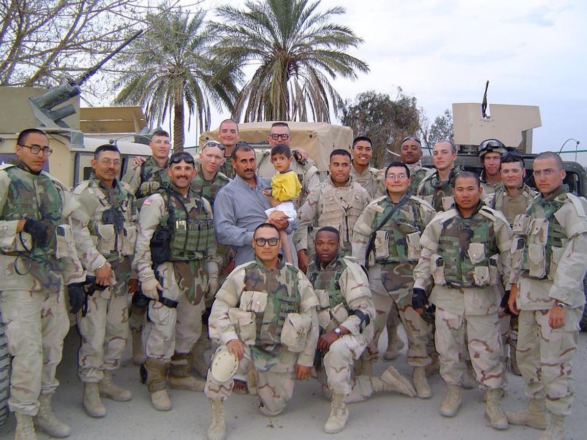 Joseph Murphy's Alaska National Guard unit in Iraq, 2005. Murphy is kneeling, on the left. Ed Irizarry, standing left of Murphy, led the unit. He called Murphy