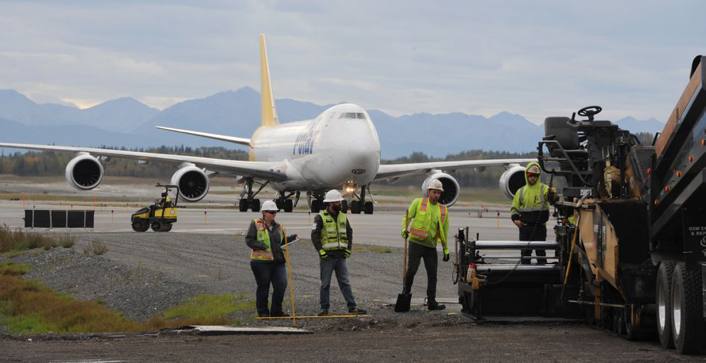 A crew from McKenna Brothers Paving works on a taxiway as construction work on Runway 15-33, the north-south runway at Ted Stevens Anchorage International Airport nears completion.