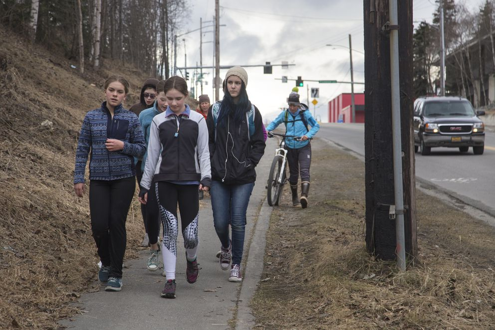 Seventh-grade girls walk to the BP Energy Center for yoga after their bicycles were stolen from Steller Secondary School on Monday. The girls are in the fourth week of the six-week bike mentorship program, Anchorage GRIT. After the six weeks, the girls would have earned the bicycles donated by Specialized. (Rugile Kaladyte / Alaska Dispatch News)