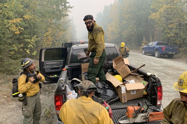 Firefighters from the Snake River Valley Type 2 crew, up from Oregon, prepare for a day of fighting the Swan Lake fire with an operations update Friday morning, Aug. 30, 2019. (Jeff Parrott / ADN)