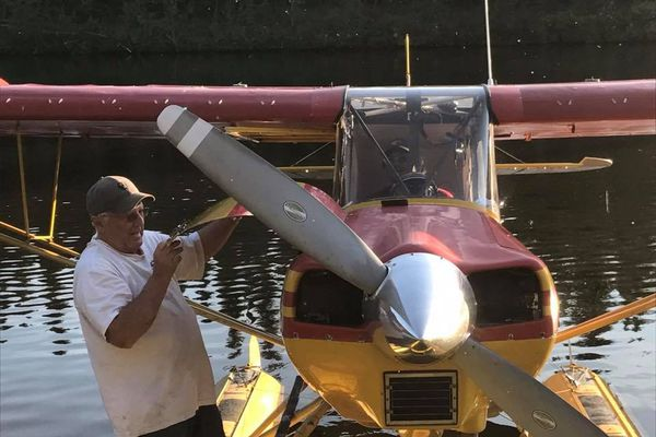 Former commercial pilot and smalltime North Slope investor Andy Bachner checks the engine of his floatplane. Bachner, 76, is one a few investors who try to make money selling oil leases on the North Slope to companies that will develop them. (Clay Baldwin)