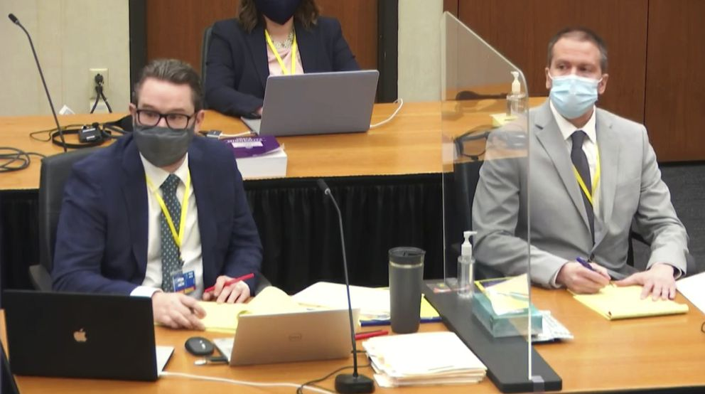 In this image from video, defense attorney Eric Nelson, left, and defendant former Minneapolis police Officer Derek Chauvin listen as Assistant Minnesota Attorney General Matthew Frank, questions witness Christopher Martin on Thursday. (Court TV via AP, Pool)