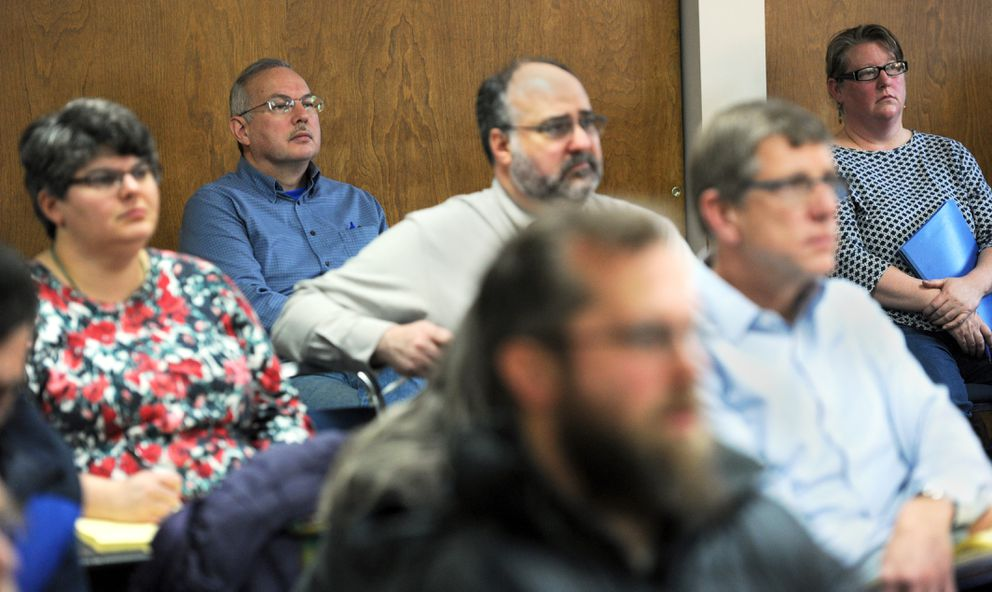 Rep. Bryce Edgmon, second from left in back, drops in to listen to testimony during a public hearing with the visiting state Local Boundary Commission on Tuesday in Dillingham. His wife Melody Nibeck, back right, was coordinating the commission's visits to Manokotak and Dillingham as a local government specialist with the Alaska Department of Commerce, Community and Economic Development. (Erik Hill / Alaska Dispatch News)