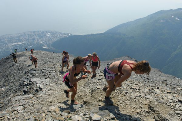Runners climb to the peak during the Mount Marathon women's race on July 4, 2019, in Seward. (Marc Lester / ADN)