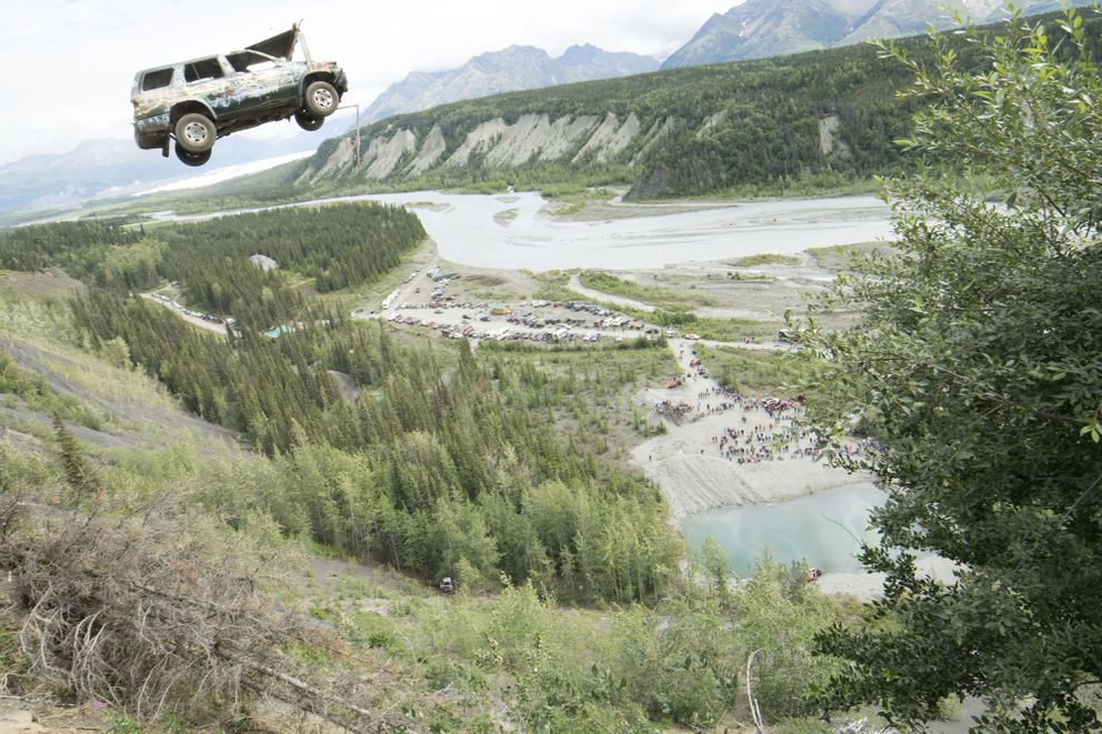 An SUV becomes airborne after being launched off a cliff in the Glacier View area during the community's Fourth of July celebration. (Patrick Penoyar)