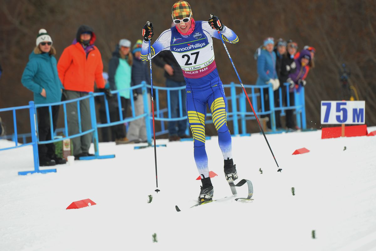 Everett Cason of Anchorage reaches the finish line despite a broken ski Wednesday at the Junior National cross-country ski championships at Kincaid Park. (Photo by Michael Dinneen)