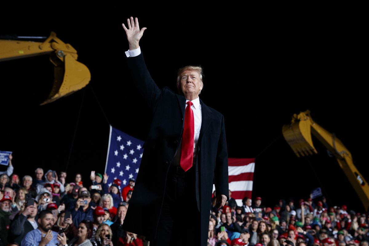 President Donald Trump waves as he leaves a campaign rally, Friday, Oct. 12, 2018, in Lebanon, Ohio. (AP Photo/Evan Vucci)