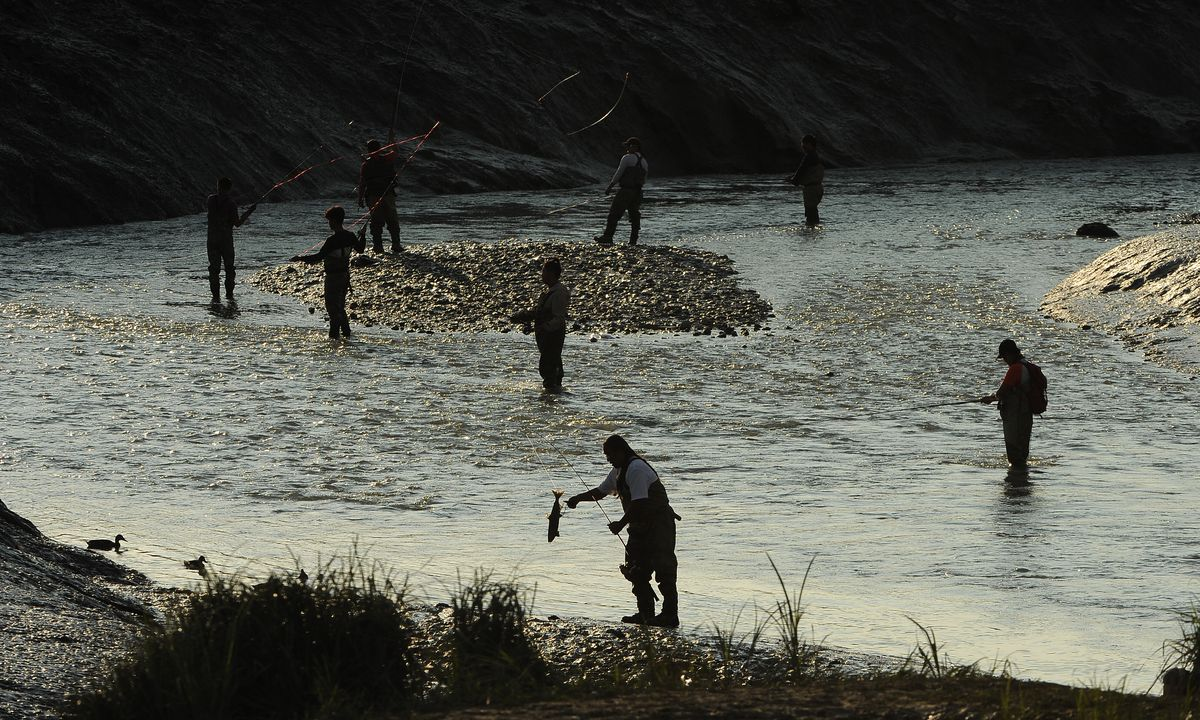 Salmon fishers ply the waters of Ship Creek in Anchorage, AK on Thursday, July 25, 2019. (Photo by Bob Hallinen)