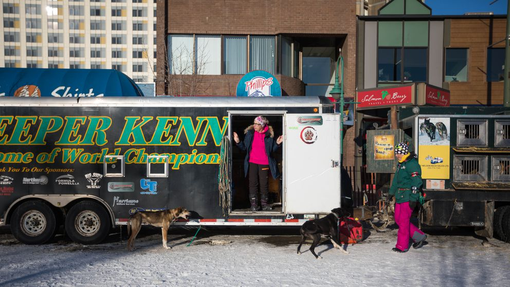 Maria Gladh looks out of the Streeper Kennel trailer during the second day of the Fur Rondy Open World Championship Sled Dog Race on Saturday, Feb. 23, 2019. Gladh is musher Lina Streeper's mom, and each winter she spends two or three months playing nanny/grandma to 8-year-old Alva Streeper and 6-year-old Clara Streeper so that Lina and her husband Buddy can race sled dogs. (Loren Holmes / ADN)