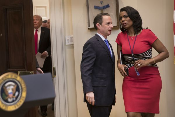 Omarosa Manigault Newman and Reince Priebus, then the White House Chief of Staff , confer as President Donald Trump arrives in the Roosevelt Room of the White House in Washington, Feb. 16, 2017. (Stephen Crowley/The New York Times file)