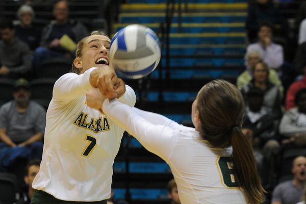 Leah Swiss, of UAA, goes for the bump as teammate Casey Davenport backs her up against Chico State in the 2017 West Region Showcase volleyball action at the Alaska Airlines Center at UAA in Anchorage, Alaska on Thursday, Sept. 7, 2017. (Bob Hallinen / Alaska Dispatch News)