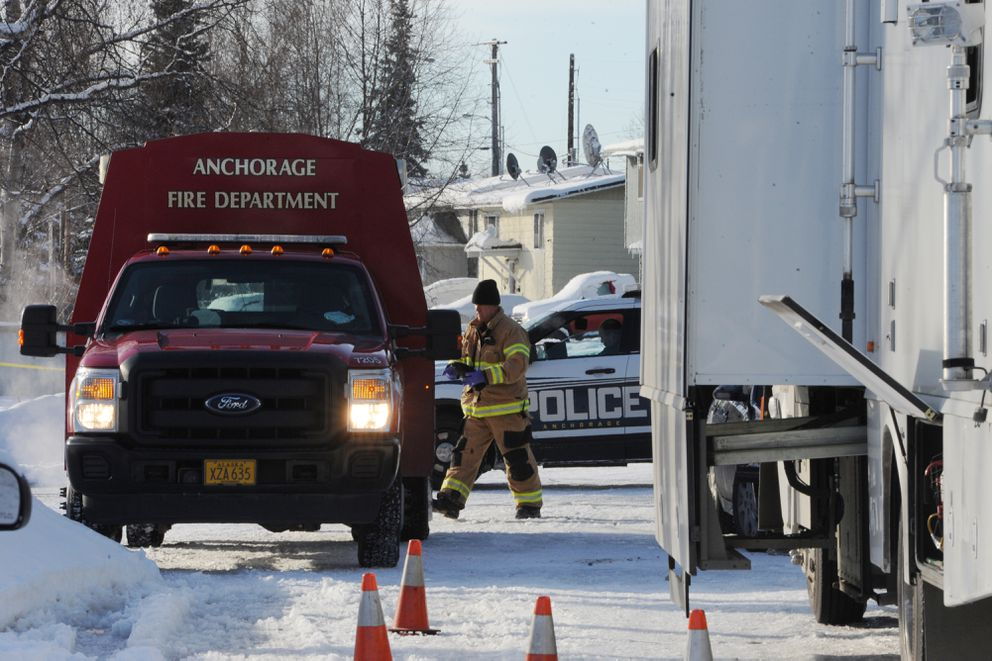 Anchorage police and firefighters investigate an early morning fire and suspicious death at a Nunaka Valley home on Thursday, Feb. 21, 2019. (Bill Roth / ADN)