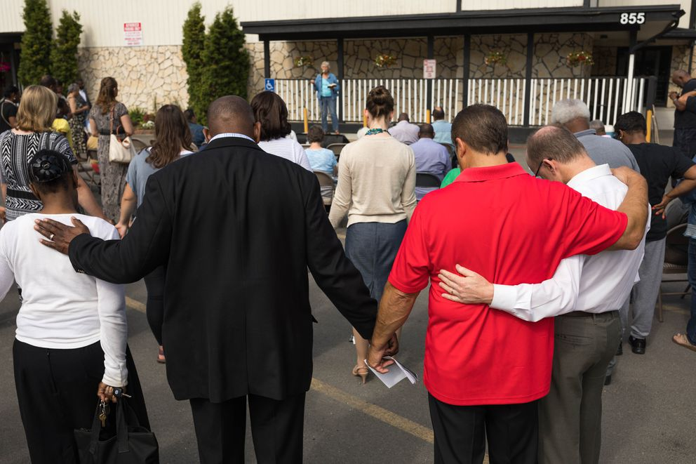 People pray during a prayer vigil Saturday, Aug. 10, 2019 at Shiloh Baptist Church. The vigil was held in response to the recent shootings in El Paso, Texas and Dayton, Ohio. (Loren Holmes / ADN)