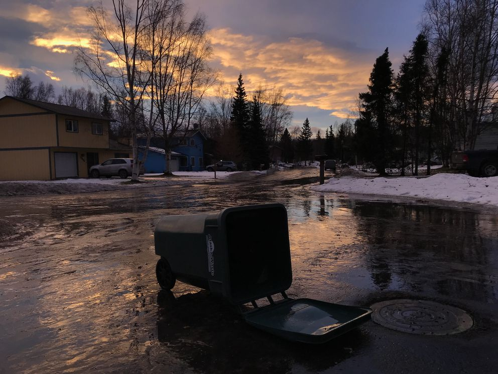 A wind-toppled trash bin sits on ice Monday morning, Dec. 11, 2017, in East Anchorage. (Bill Roth / Anchorage Daily News)