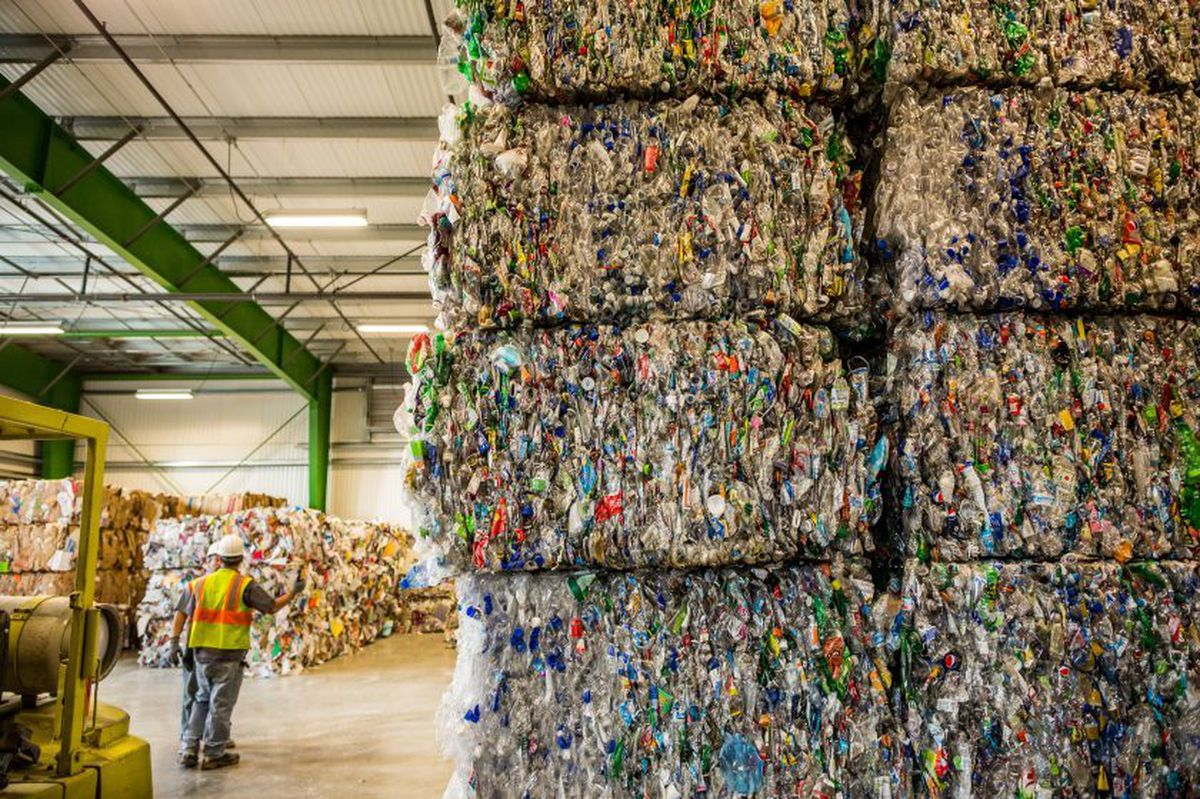 Bales of plastic bottles are stacked inside the new Palmer recycling center on Wednesday, June 18, 2014. The 23,600 square foot facility has an enclosed drop-off space and a larger baler, which will allow the facility to divert more waste from the landfill.