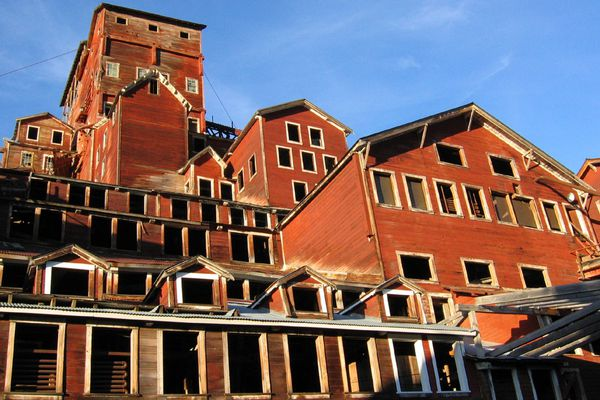 The National Park Service licenses local guides to offer tours of the mill building at Kennecott Mill Town in Wrangell-St. Elias National Park.