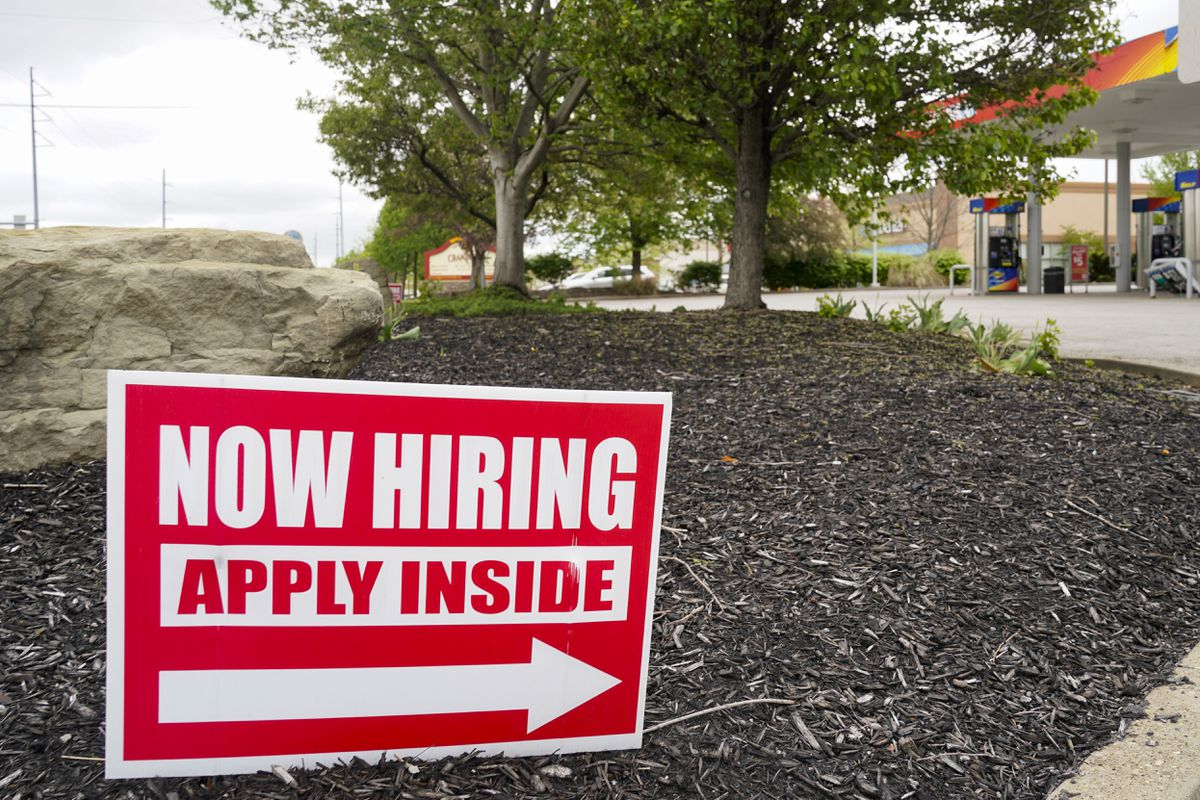 Hiring signs are posted outside a gas station in Cranberry Township, Butler County, Pa., Wednesday, May 5, 2021. (AP Photo/Keith Srakocic)