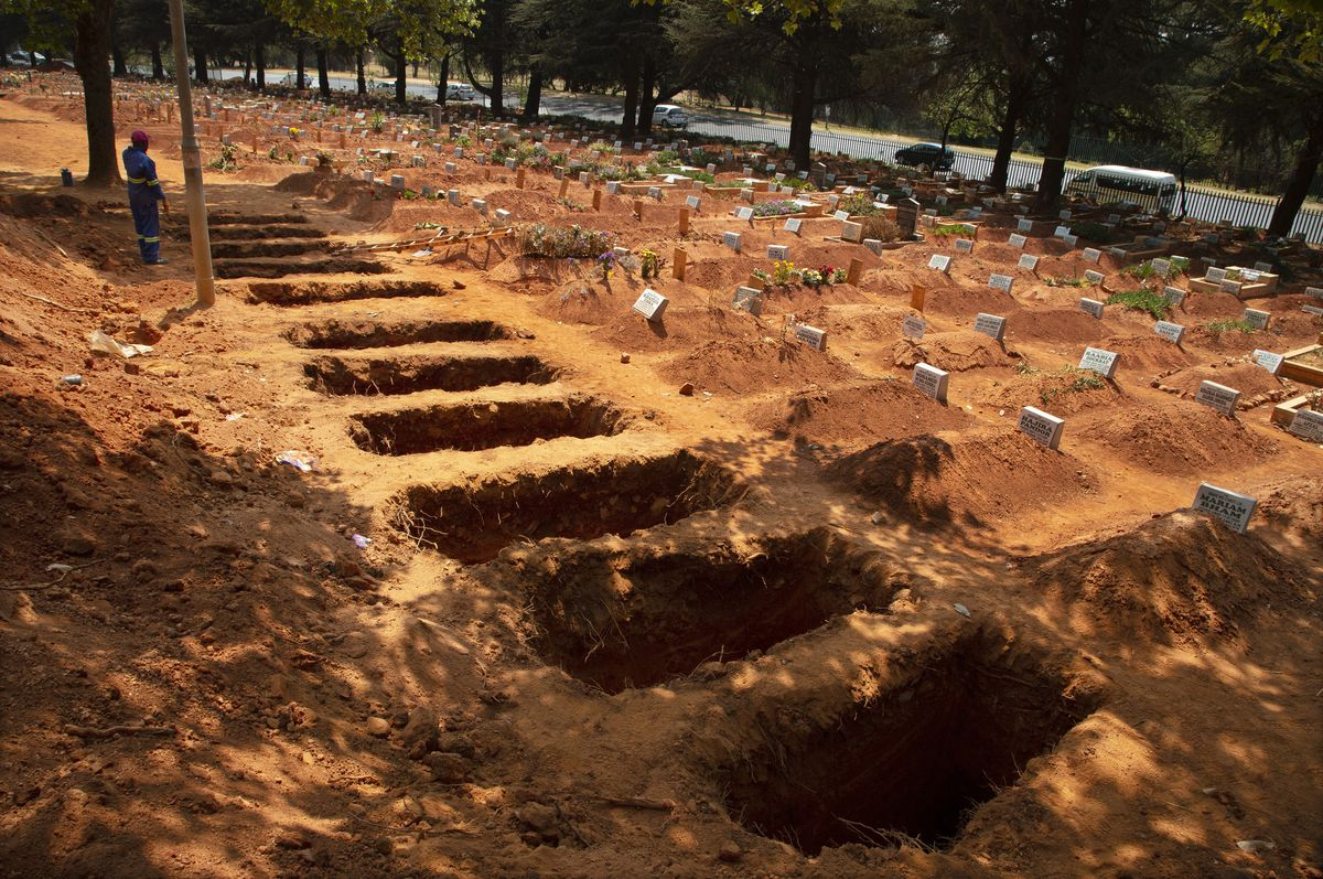A grave digger works at the city's main Westpark Cemetery in Johannesburg, Wednesday, Sept. 23, 2020. (AP Photo/Denis Farrell)