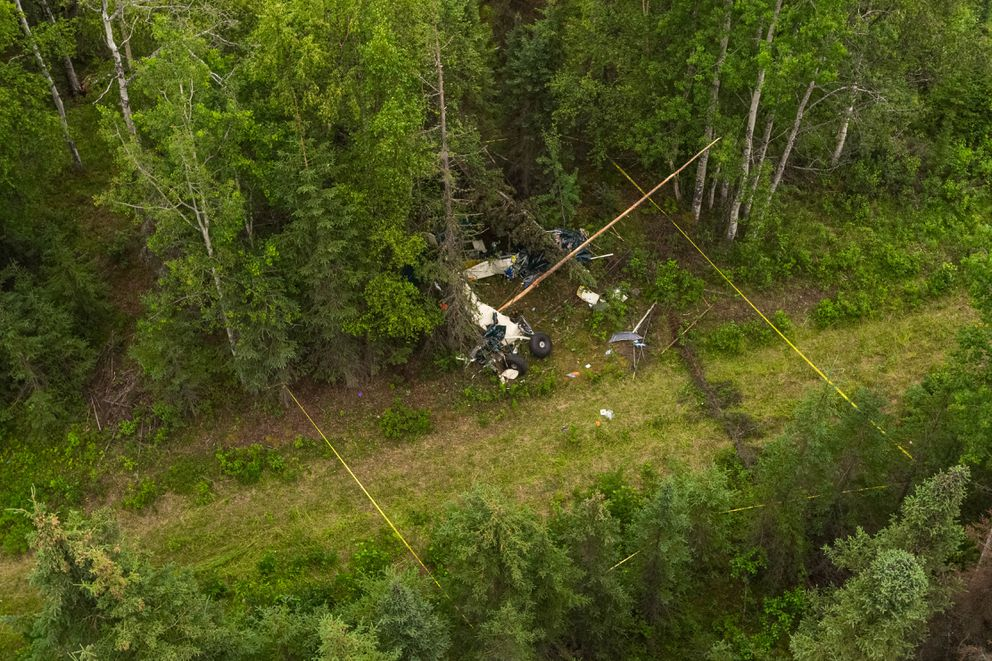 Wreckage from a fatal midair collision lies in the woods on Friday near the Sterling Highway and Mayoni Street in Soldotna. (Loren Holmes / ADN)