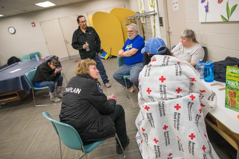 Chaplain Margaret Griffo talks with Brieanna Brooks at the Spenard Recreation Center on Wednesday. (Loren Holmes / Alaska Dispatch News)