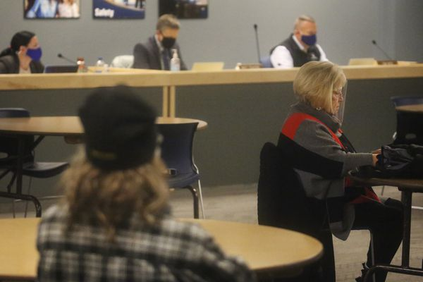 Members of the public listen to Anchorage School Board members speak during a special meeting at the Anchorage School District office on Monday, Nov. 9, 2020. (Emily Mesner / ADN)