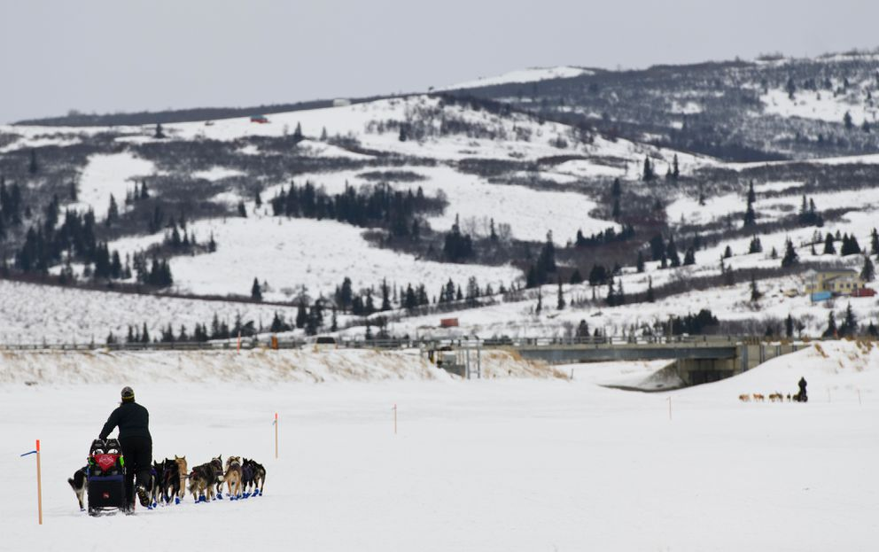 Jessie Royer, left, and Joar Leifseth Ulsom leave Unalakleet during the Iditarod on March 10, 2019. (Marc Lester / ADN)