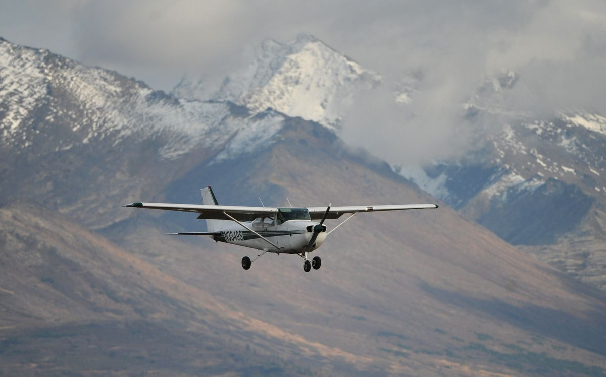 Land and Sea Aviation Alaska flight instructor Andrew Nelson and student pilot Cole Harkovitch make an approach to Runway 25 while doing touch and gos at Merrill Field on Oct. 3, 2016. (Bill Roth / Alaska Dispatch News)