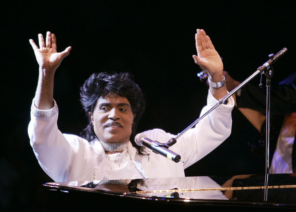 """FILE - In this Aug. 19, 2004 file photo, Little Richard performs at Westbury Music Fair in Westbury, NY. Little Richard, the self-proclaimed """"architect of rock 'n' roll"""" whose piercing wail, pounding piano and towering pompadour irrevocably altered popular music while introducing black R&B to white America, has died Saturday, May 9, 2020. (AP Photo/Ed Betz, File)"""