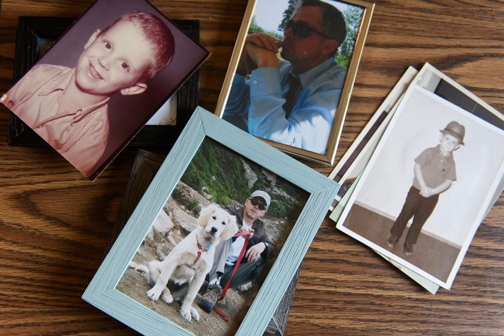 Buddy and Jolene Orand show photos of their son, Joseph 'Grant ' Orand on April 9, 2019. Grant's body was discovered in Anchorage woods after he had been missing for months. (Marc Lester / ADN)