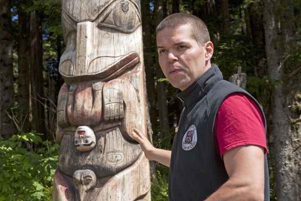 Sitka Tribe of Alaska's Mark Sixby talks about the totems at the Sitka National Historical Park Thursday, July 5, 2018 in Sitka, Alaska. Sitka Tribe of Alaska is collaborating with the National Park Service to interpret the park's holdings this year after the first of its kind agreement was signed between STA and the Department of the Interior. (James Poulson/Daily Sitka Sentinel via AP))