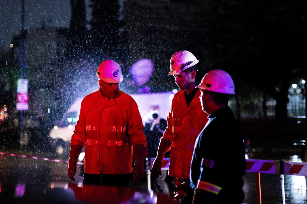 "Technicians of Edenor electricity company stand under the rain as they work to fix a generator during a blackout in Buenos Aires, Argentina, Sunday, June 16, 2019. A massive blackout left tens of millions of people without electricity in Argentina, Uruguay and Paraguay on Sunday in what the Argentine president called an ""unprecedented"" failure in the countries' power grid. (AP Photo/Tomas F. Cuesta)"