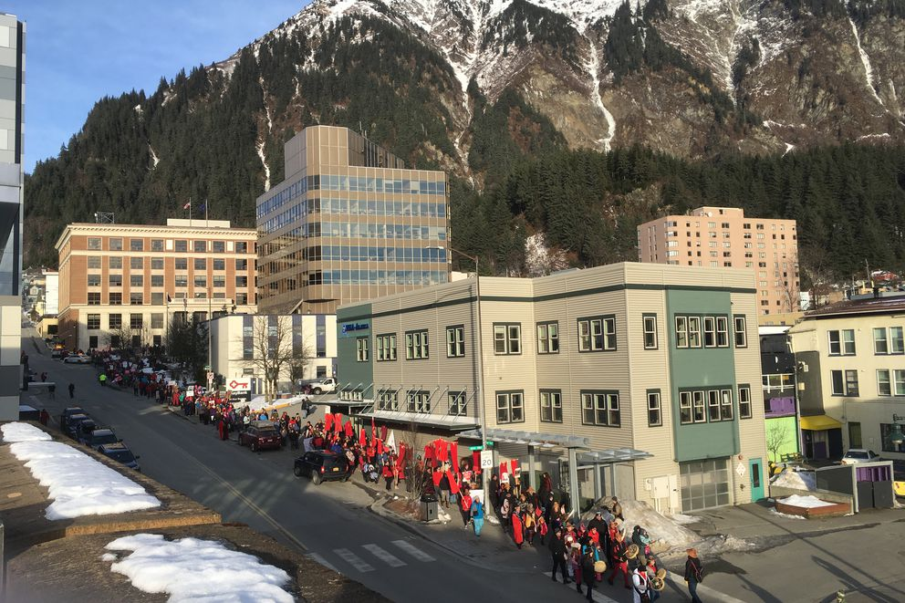 An estimated 650 people marched from the state capitol to Centennial Hall in Juneau on Saturday, Jan. 19, 2018 for the third Women's March. Participants dressed in red in solidarity with Native women who have gone missing or been killed. (Photo: James Brooks / ADN)