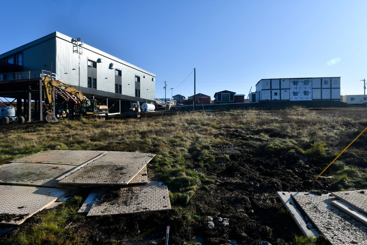 The 9,600-square-foot Mertarvik Evacuation Center, left, will serve as a community center and will house the village's school temporarily. (Marc Lester / ADN)