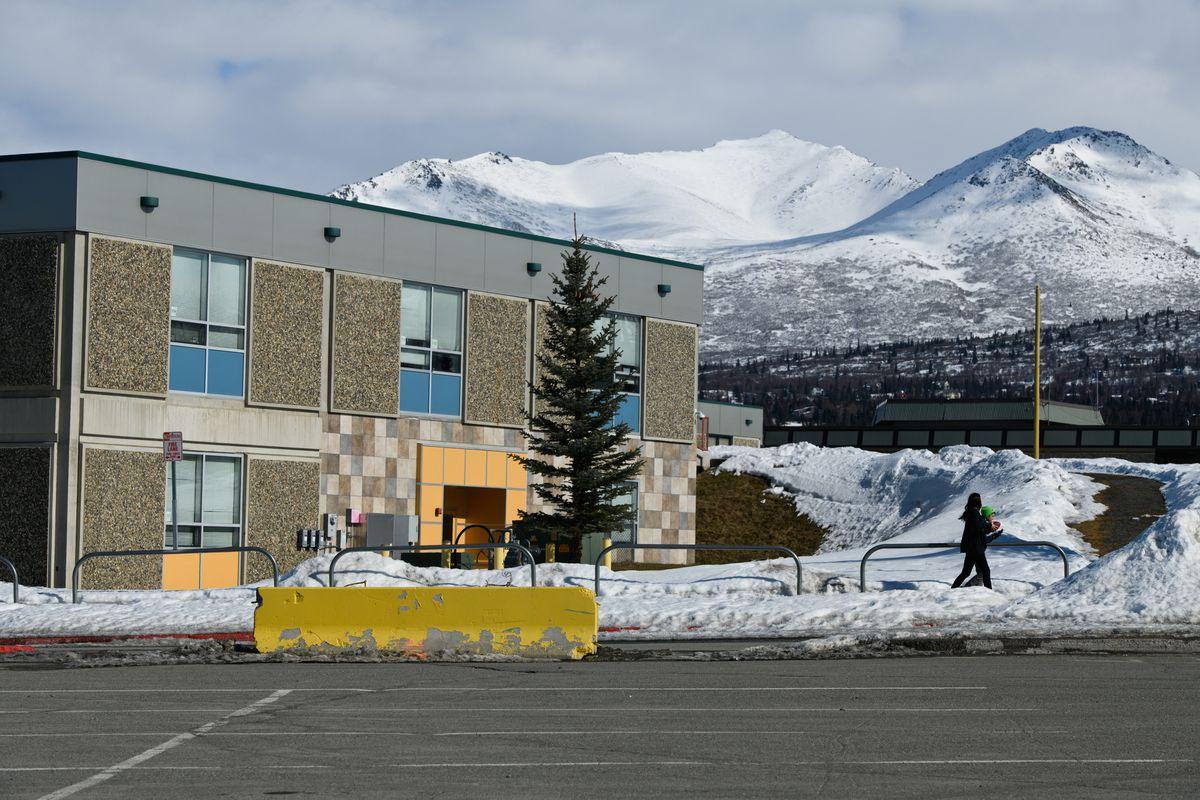 Kids walk near closed Service High School on April 6, 2020. (Marc Lester / ADN)