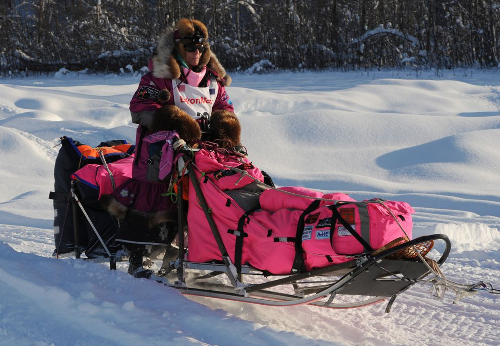 DeeDee Jonrowe hits the Susitna River during the Iditarod in March. (Bill Roth / ADN)