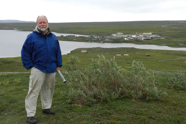Ed Rastetter stands on a small hill overlooking Toolik Field Station on August 1, 2017. (Kelsey Lindsey)