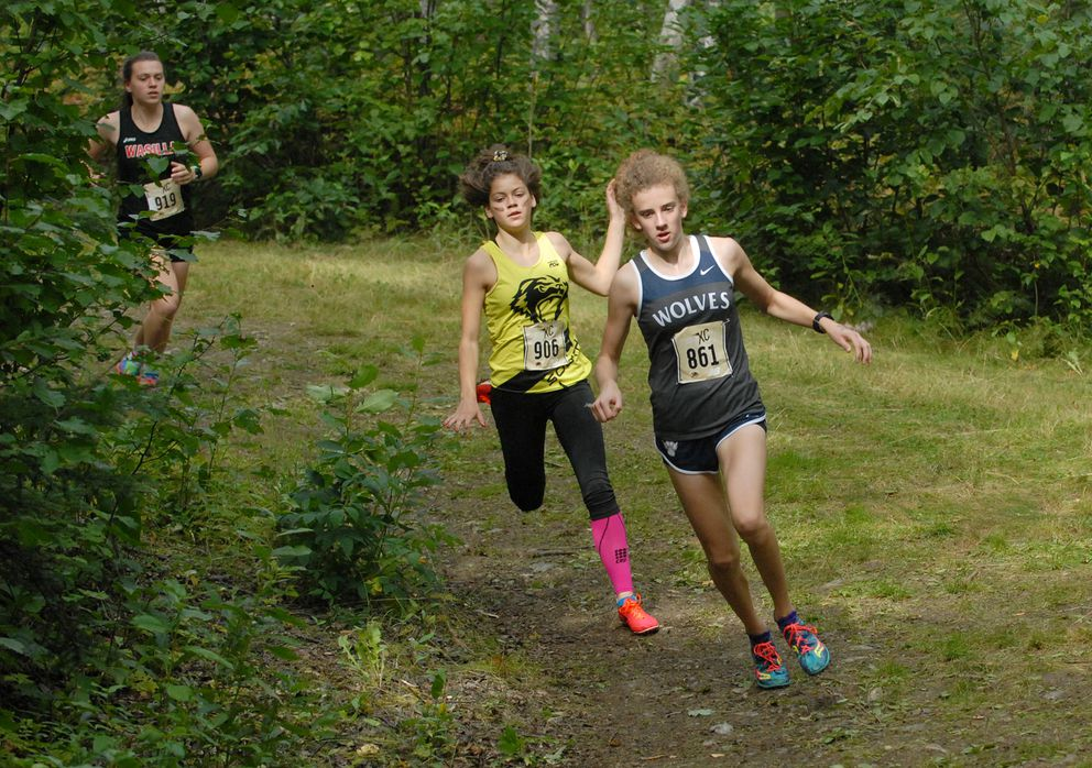 Eagle River's Emily Walsh leads South's Ava Earl and Wasilla's Allison VanPelt during the State Preview cross country running meet at Bartlett High on Saturday, Aug. 25, 2018. Walsh won the race in 18 minutes, 43 seconds. Palmer's Katey Houser was second in 18:55. (Matt Tunseth/Chugiak-Eagle River Star)