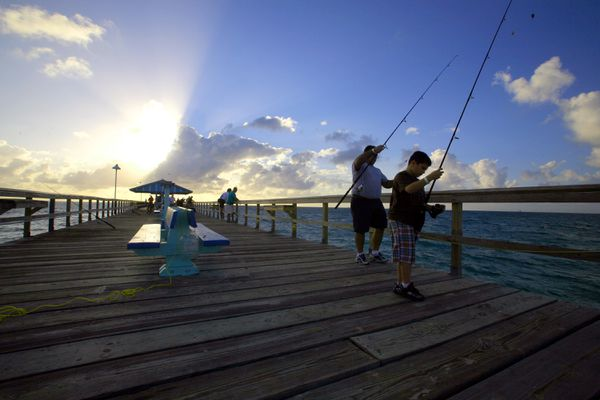 Fishermen at sunrise at Anglin's Pier in Lauderdale-by-the-Sea, north of Fort Lauderdale Florida. (Alex Quesada/The New York Times archive)