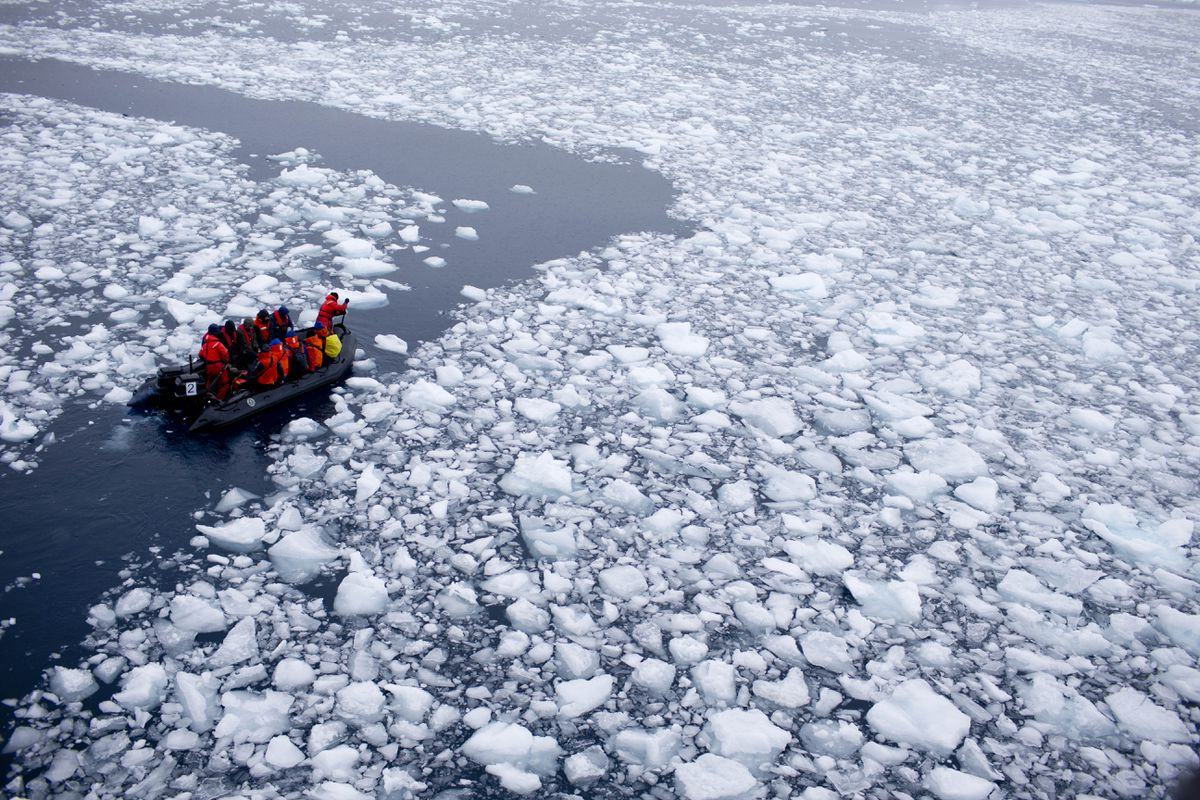 In this Jan. 22, 2015 photo, a zodiac carrying a team of international scientists heads to Chile's station Bernardo O'Higgins, Antarctica. Water is eating away at the Antarctic ice, melting it where it hits the oceans. As the ice sheets slowly thaw, water pours into the sea, 130 billion tons of ice (118 billion metric tons) per year for the past decade, according to NASA satellite calculations. (AP Photo/Natacha Pisarenko)