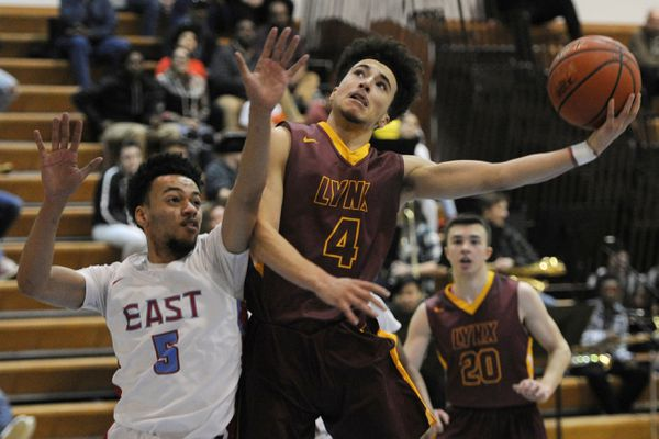 East High senior Kaeleb Johnson defends as Dimond High junior Isaiah Moses drives to the basket during the Lynx 52-45 victory over the Thunderbirds at East High on Tuesday evening, Feb 19, 2019. (Bill Roth/ ADN)