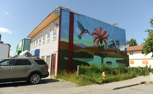 "The ""Picaflores"" mural painted by Linda Infante Lyons graces the side of the Mountain View Hispanic Cultural Center in Anchorage on July 7. (Bob Hallinen / ADN)"
