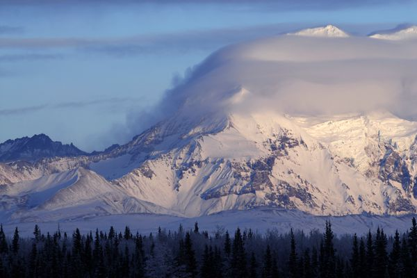 Clouds cover a portion of 12,010-foot Mount Drum in Wrangell-St. Elias National Park on December 16, 2006.