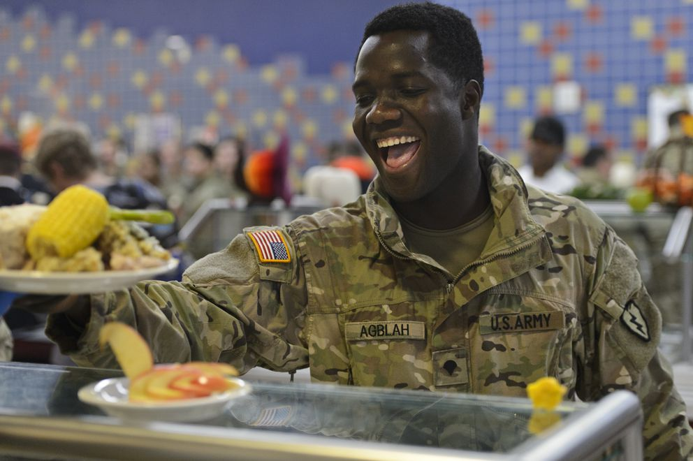 Spc. Kodjo Agblah is handed his heaping plate of food. (Marc Lester / ADN)