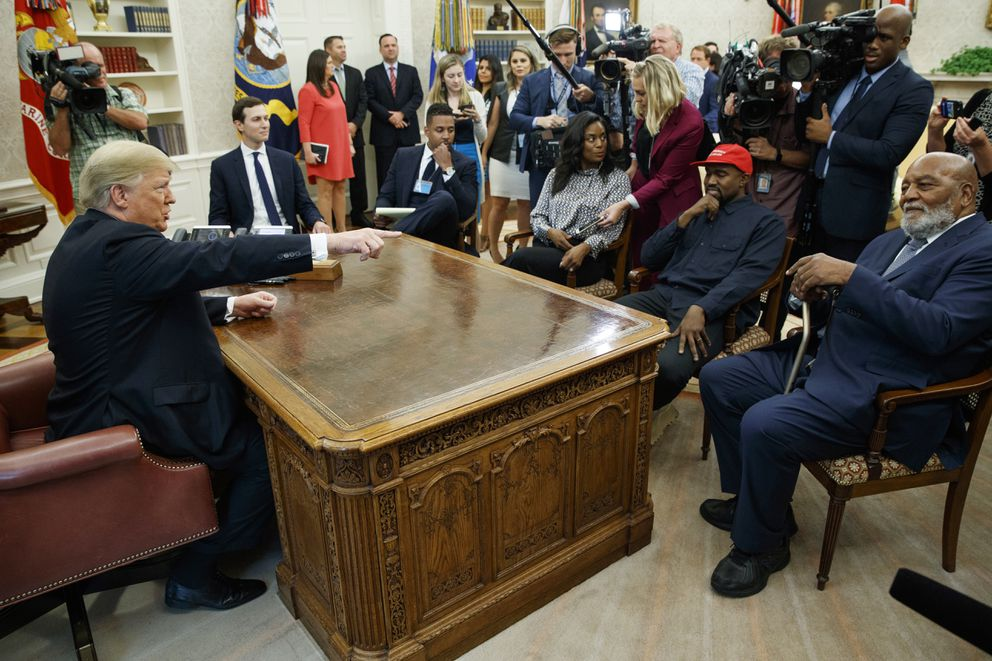 President Donald Trump meets with rapper Kanye West and former football player Jim Brown in the Oval Office of the White House, Thursday, Oct. 11, 2018, in Washington. (AP Photo/Evan Vucci)