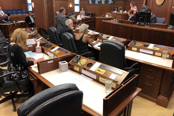 Empty desks are seen Tuesday, July 9, 2019 as the Alaska Senate convenes a floor session in Juneau. (James Brooks / ADN)