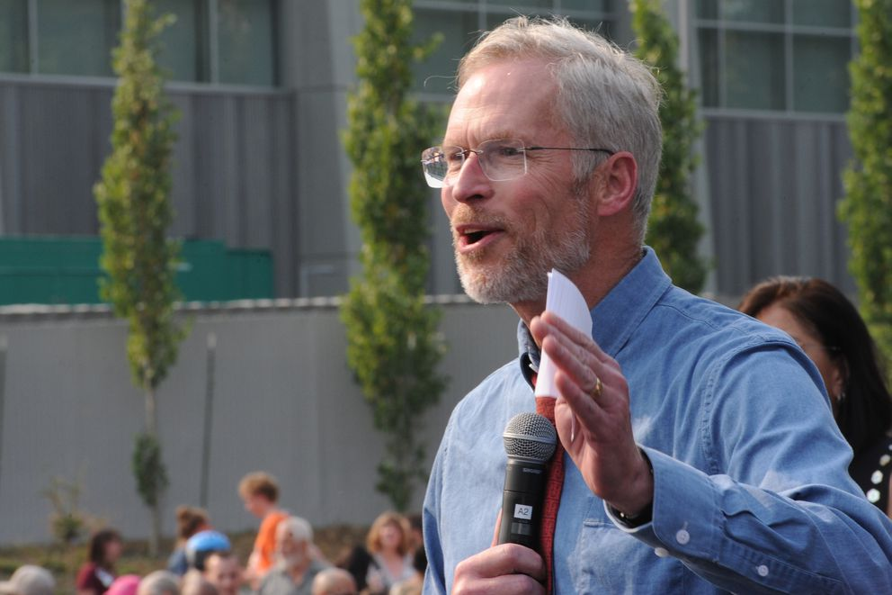 University of Alaska president Jim Johnsen talks to a crowd that gathered at the Alaska Airlines Center last month to protest Gov. Mike Dunleavy's budget vetoes. (Bill Roth / ADN)