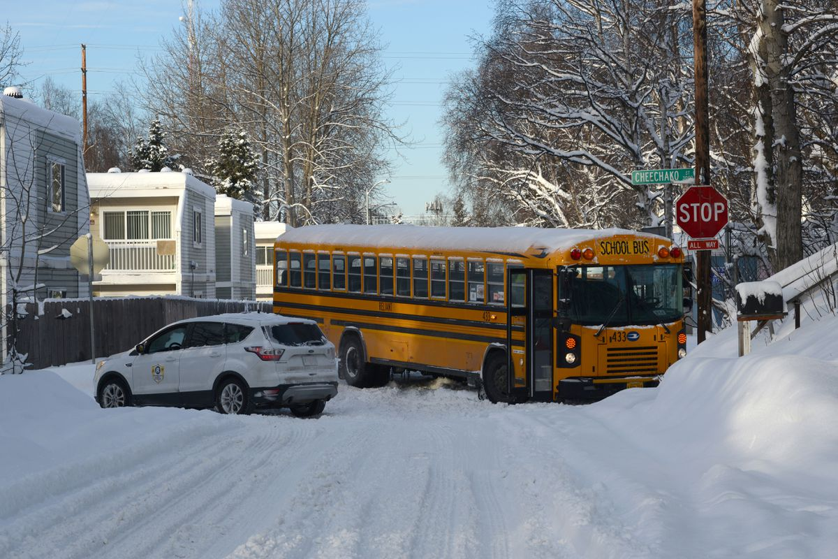 A school bus was stuck at 31st Avenue and Cheechako Street on Tuesday morning after a snowstorm moved through the Anchorage area. (Anne Raup / ADN)