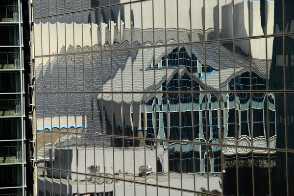 The Alaska Center for the Performing Arts in reflected in the Atwood Building in downtown Anchorage, AK on Wednesday, June 21, 2016. (Bob Hallinen / Alaska Dispatch News)